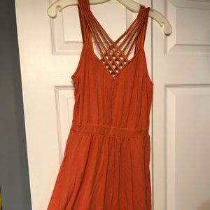 Sleeveless orange cocktail dress
